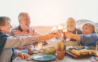 oakleigh-senior-living group of seniors smiling at dinner table