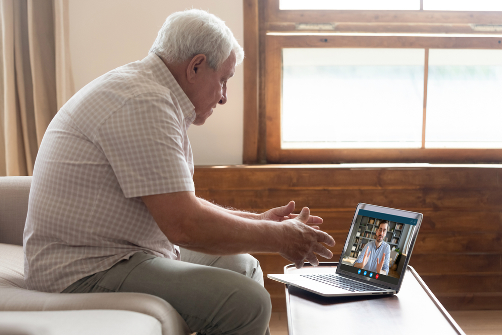 connect with seniors senior man on video chat on laptop