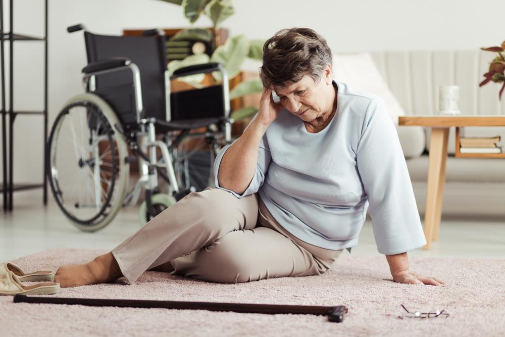 prevent seniors from falling senior woman on the floor holding head