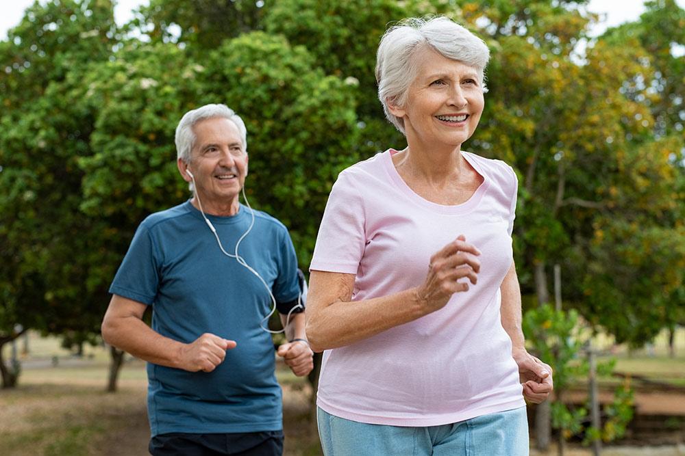 Oakleigh Macomb senior man and woman jogging