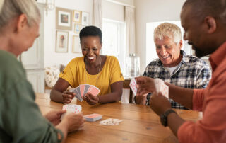 Oakleigh of Macomb Senior Living Group of seniors playing cards