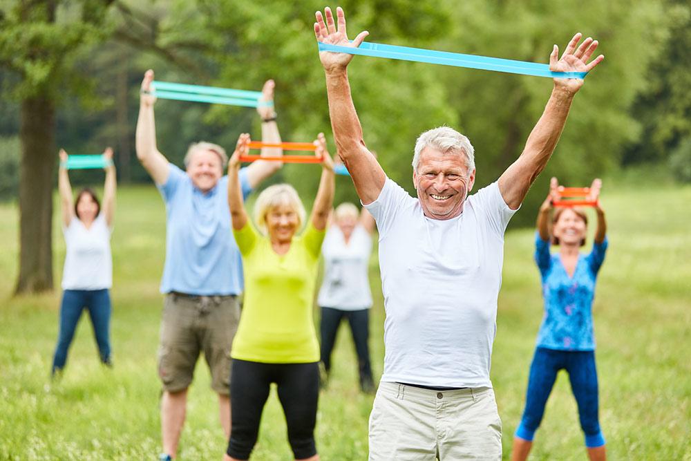 Oakleigh of Macomb Senior Living seniors exercising outside social distancing