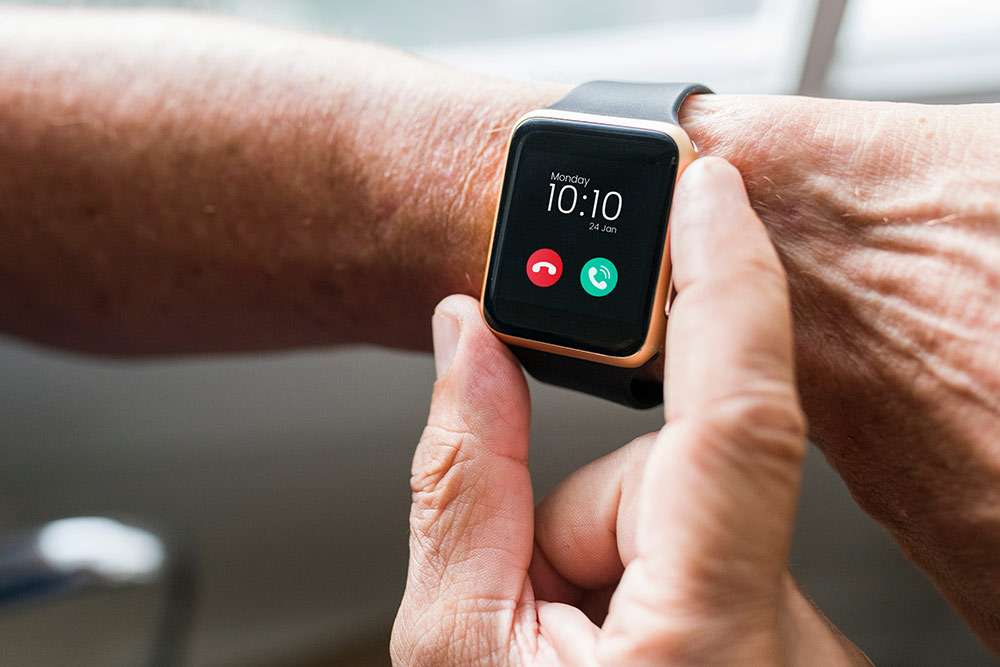 Close up of digital Apple watch on senior wrist with time showing