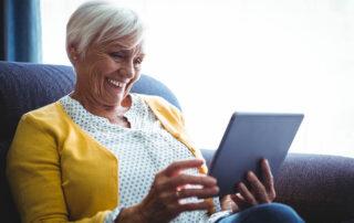Senior woman looking at digital tablet in hands
