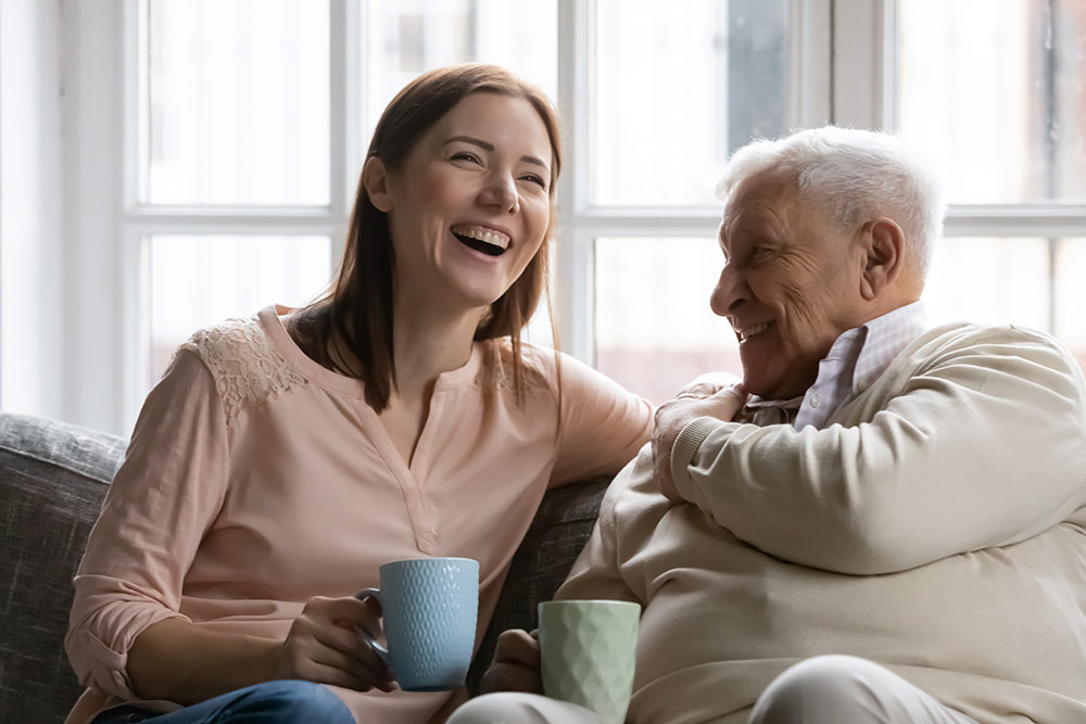 Woman visiting senior father in assisted living facility