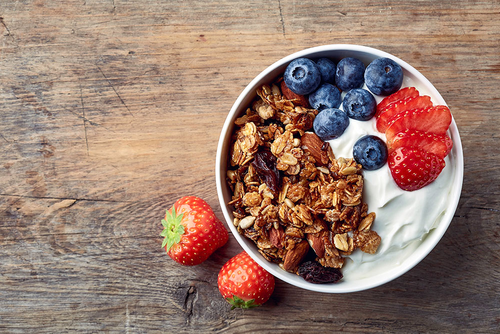 Bowl of yogurt with granola and fresh fruit